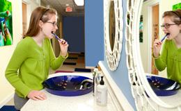 Girl Brushing Teeth at Brushing Station